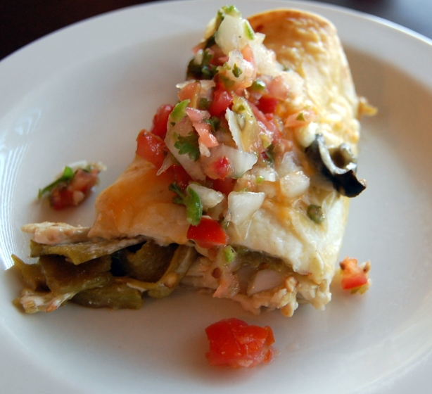 Enchilada with chicken, green chili and cream cheese salsa verde